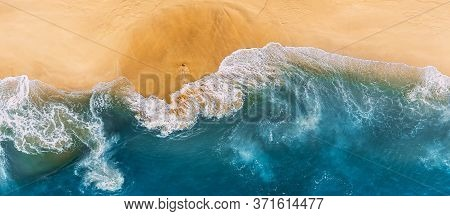 Aerial View Of Blue Ocean Waves In Kelingking Beach, Nusa Penida Island In Indonesia. Beautiful Sand