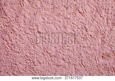 Rough, Grainy Surface Of A Plastered Wall With Pink Stucco, Abstract Texture For Background.