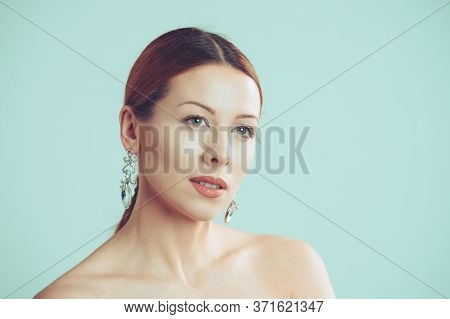 Beauty Girl Posing. Close Up Head Shot Beautiful Woman Looking To The Side In Profile Showing Clean