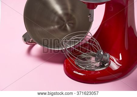 Stylish Red Kitchen Mixer With Clipping Path Isolated On Pink Background. Professional Steel Electri