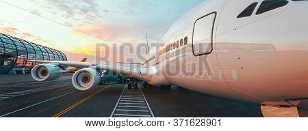 The Plane Is Parked To Load The Parcel In The Airport. The Truck Is In The Airport.3d Rendering And