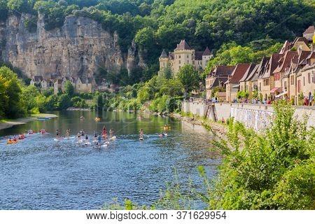 La Roque-Gageac, Dordogne, France - August 13, 2019: Canoeing on the river Dordogne at La Roque-Gageac. France