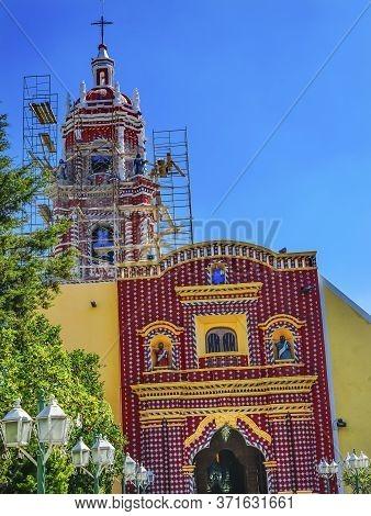 Colorful Red Yellow Church Of Templo De Santa Maria Tonantzinta Cholula Puebla Mexico.  Church Built