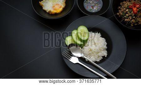 Stir Fried Minced Pork With Basil (pad Ka Prao), Rice, Fried Egg And Chili Fish Sauce On Black Dinni