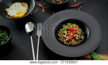 Stir Fried Minced Pork With Basil (pad Ka Prao), Fried Egg And Chili Fish Sauce Serving On Black Cer