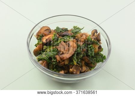 Sauteed Mushrooms, Kale And Shallot Filling Or Ingredient In Glass Bowl Set Aside For Adding To Dish