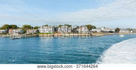 Characteristic Style Cape Cod Architecture Along Waters Edge On Martha's Vineyard, Usa.
