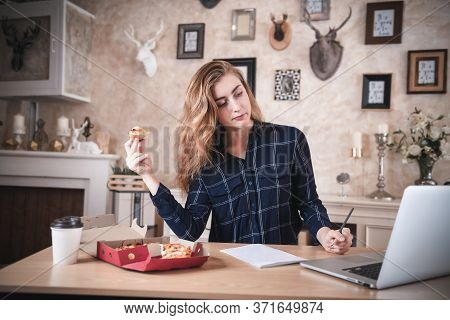Busy Businesswoman Work At Home While Working On Table Desk With Laptop At The Same Time She Eating,