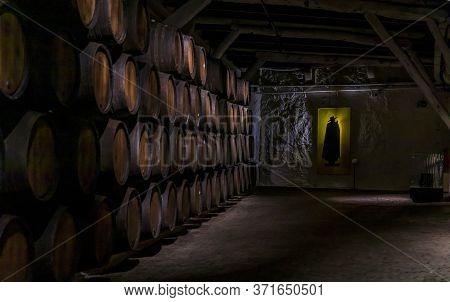 Porto, Portugal - May 31, 2018: Stored Branded Barrels Of Port Wine On Display At Sandeman Cellar, P