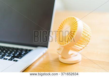 Mini Usb Fan Near Laptop. Summer Office Day. Mini Portable Cooler