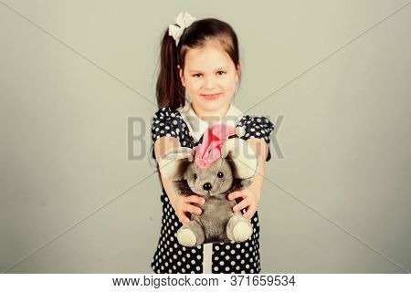 Child Care. Sweet Childhood. Childhood Concept. Lovely Small Girl With Favorite Toy. Kindergarten An