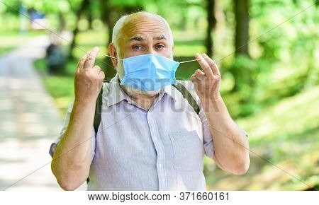 Mask Protecting From Virus. Pandemic Concept. Limit Risk Infection Spreading. Senior Man Face Mask.