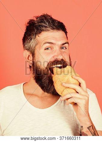 Biting Croissant. Delicious Breakfast. Man Start Morning With Croissant. Bearded Hipster Enjoy Break