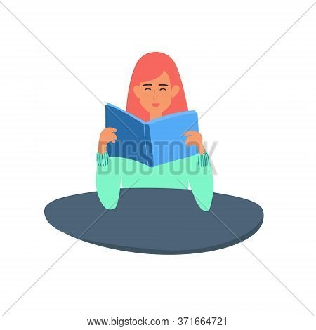 A Teenage Girl Reads A Book The Student Is Sitting At The Table, Holding A Textbook.a Teenager Is Pr