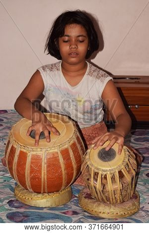 Delhi - India 15th June 2020 Close Shot Of An Indian Girl Playing Tabla Which Is A Traditional India