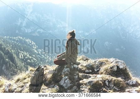 A Girl In Solitude Sits On Top Of A Mountain With Her Eyes Closed And Meditates, Or She Is In Search