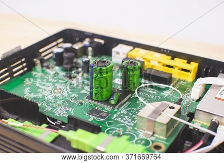 Close Up Of Electrolytic Capacitor Row With Various Sizes Place On Electronic Circuit Board