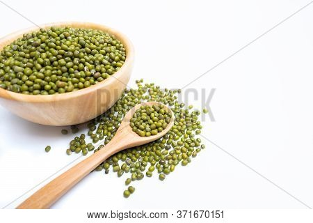 Raw Fresh Mung Beans Seed Or Organic Green Beans In A Wooden Bowl And Wooden Spoon Isolated On The W