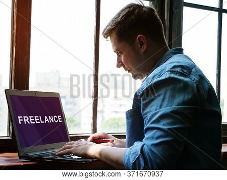 A Man Is Looking For A Freelance Job On The Internet For A Freelancer.