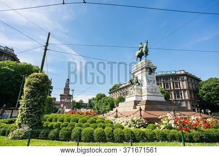 Milan. Italy - May 21, 2019: Giuseppe Garibaldi Monument in Milan and Sforza Castle (Castello Sforzesco). Cairoli Square.