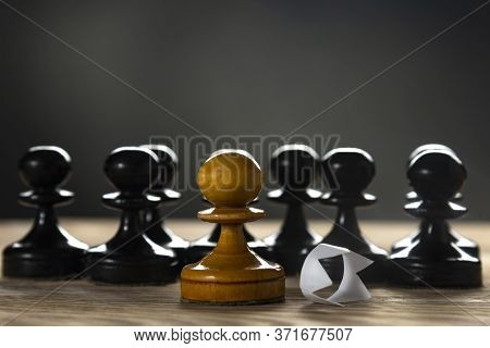 White Pawn With A Discarded Paper Crown. Black Lives Matter