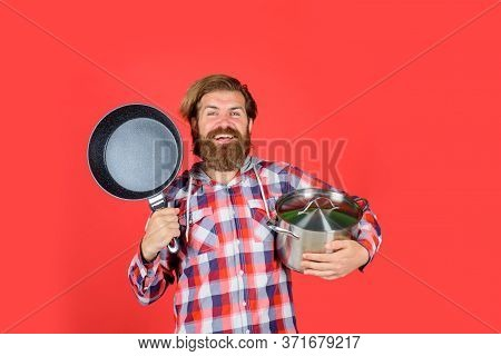 Man With Fry Pan And Saucepan. Happy Chef With Frypan. Saucepan. Fry-pan. Cooking. Kitchenware. Cook