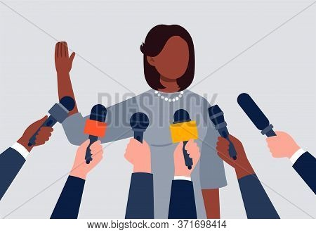 Live Report, Live News Concept. An African-american Woman Giving An Interview. Many Hands Of Journal