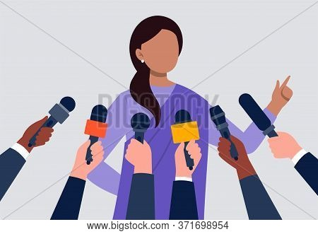 Live Report, Live News Concept. An Indian Woman Giving An Interview. Many Hands Of Journalists With
