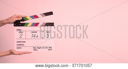Hand Is Holding Clapper Board Or Movie Slate.it 's Used In Video Production And Film Industry On Whi