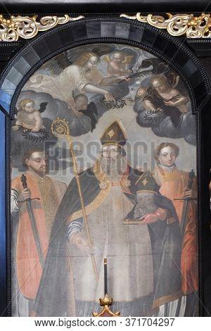 ZAGREB, CROATIA - SEPTEMBER 26, 2018: Saint Denis holding his head, altar of Saint Dionysius in the Church of Saint Catherine of Alexandria in Zagreb, Croatia