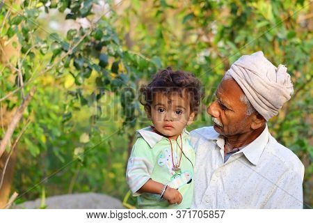 A Young Child And Grandfather In The Garden , India, Photo Of Grandfather And Grandson Walking Toget