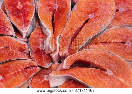 Lot Of Pieces Raw Pacific Red Fish Chinook Salmon Cut Into Steak And Ready For Cooking Various Delic