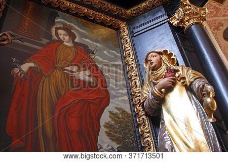 ZAGREB, CROATIA - MAY 16, 2013: Saint Apollonia and Saint Teresa of Avila, altar of Saint Apollonia in the Church of Saint Catherine of Alexandria in Zagreb, Croatia