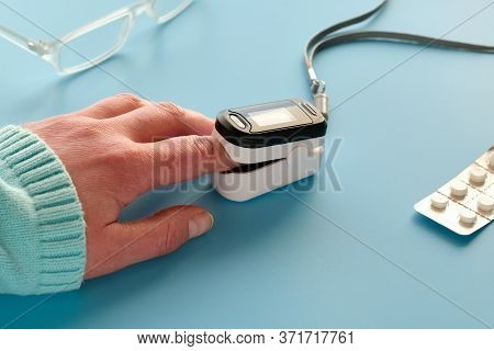 Pulse Oximeter, Finger Digital Device To Measure Persons Oxygen Saturation. Reduced Oxygenation Is A