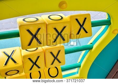 Tic-tac-toe Puzzle Game On Playground Structure For Children Education And Activity. Rolling Boxes W