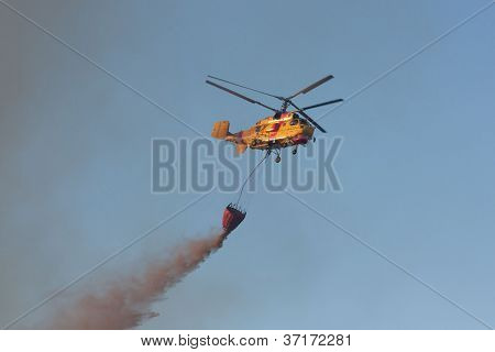Pombal, Portugal - July 15: Fire Rescue Heavy Helicopter Dropping Water On A Wildfire, In Pombal, Po
