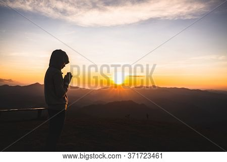 Woman Praying Hands With Faith In Religion And Belief In God On The Morning Sunrise Background. Nama