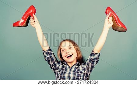 Rea Happiness. Happy Child Hold Fashionable Shoe. High Heel Lover. Shoes Fetish Shopping. Beauty And
