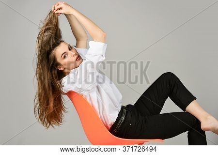 Hair Like Fire. Sensual Woman Sit On Chair. Female Relax In Office. Fashion Makeup And Cosmetics. Be