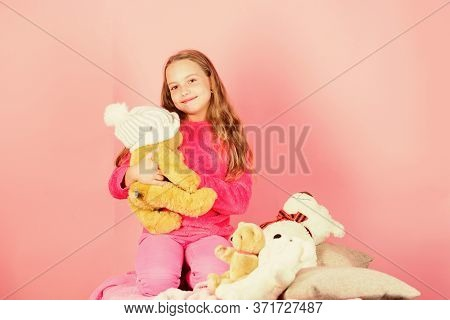 Kid Little Girl Play With Soft Toy Teddy Bear Pink Background. Child Small Girl Playful Hold Teddy B