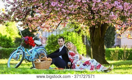 Happy Loving Couple Relaxing In Park With Food. Romantic Picnic With Wine. Give Uncommon, Unique Gif