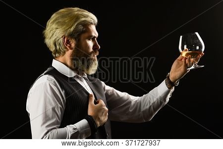 Matured In Sherry Casks. Whisky Tasting. Bearded Businessman In Elegant Suit With Glass Of Whisky. E