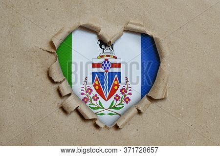3d Illustration. Heart Shaped Hole Torn Through Paper, Showing Yukon Flag