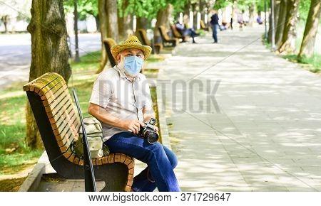 Pandemic Concept. Professional Photographer Work During Coronavirus Quarantine. Risky Photographer.