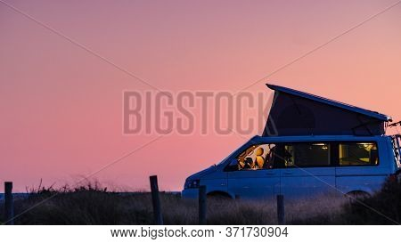 Camper Van With Roof Top Tent Camping On Mediterranean Coast. Holidays And Travel In Motorhome.