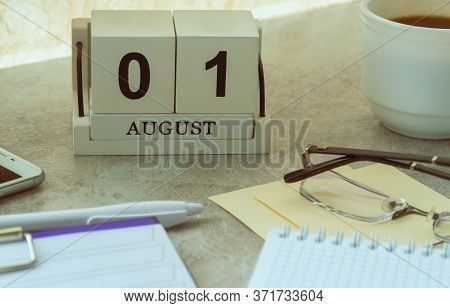 August 01, Date On The Calendar. Handmade Wood Cube With Date Month And Day. Planning For The Day. A