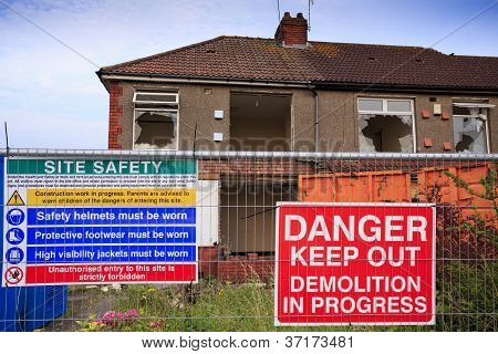 Houses ready to be demolished with Health and Safety Notices