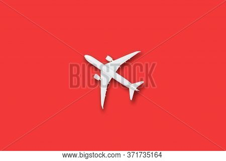 Model White Plane, Airplane On Red Color Background With Copy Space, Flat Lay Design Travel Concept