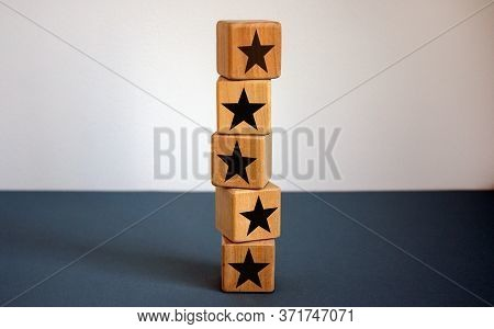 Wood Cubes With Star Sign On Beautiful Blue Table, Copy Space. White Background. Quality And Luxury