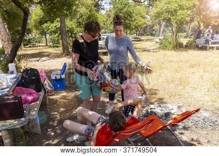 Israel. Carmel Mountain National Park. 06/06/2020. Happy Family Resting On A Picnic At The Weekend.a